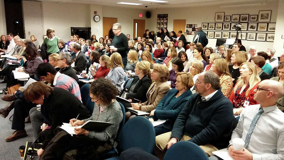 A full house was on hand as the Board of Education adopted a $157 million budget for the 2014-15 fiscal year, a spending package that moves on for action by other town boards. Photo: Andrew Brophy / Fairfield Citizen contributed