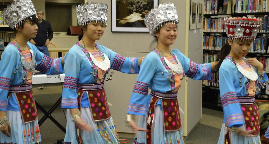 Teenagers visiting Westport from the Guang Xi province of China performed traditional dances Thursday at the Westport Library to mark the start of the Yaer of the Horse. Photo: Jarret Liotta / Westport News contributed