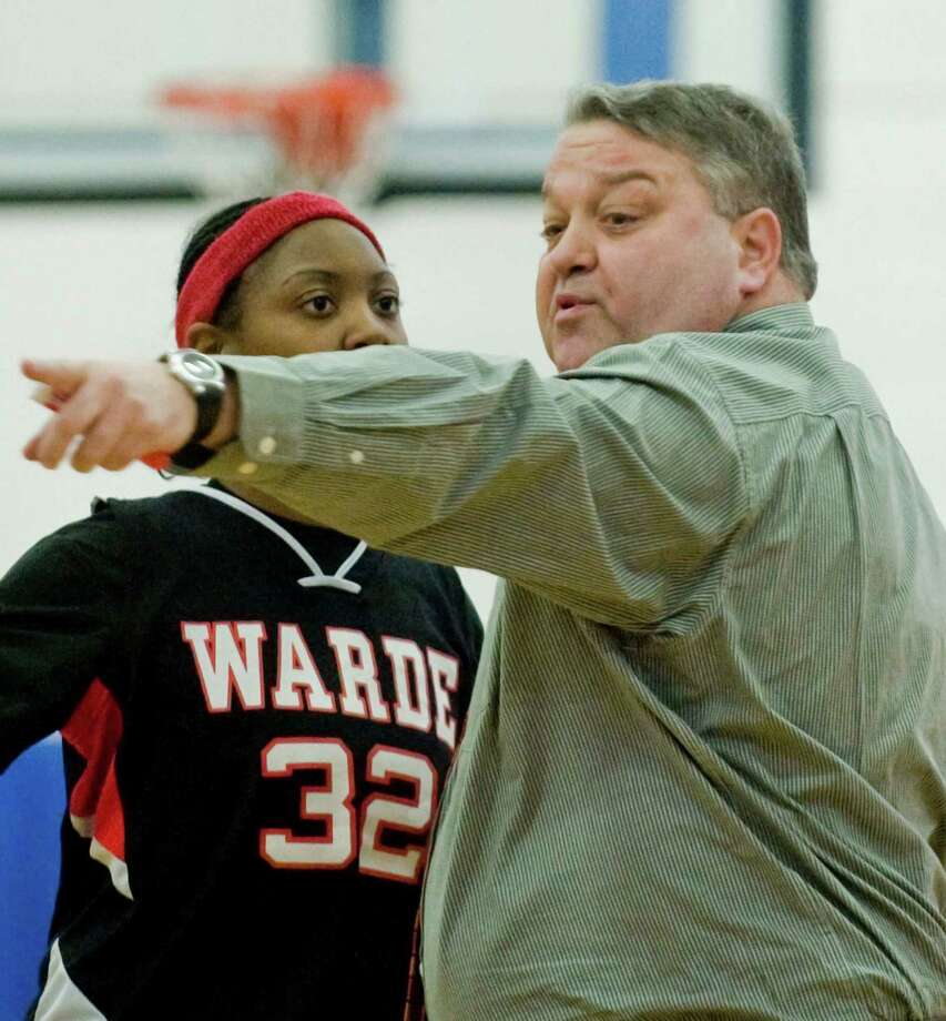 Fairfield Warde High School girls basketball head coach David Danko talks to his player during a game against Danbury High School at Danbury. Friday, Jan. 24, 2014 Photo: Scott Mullin / The News-Times Freelance
