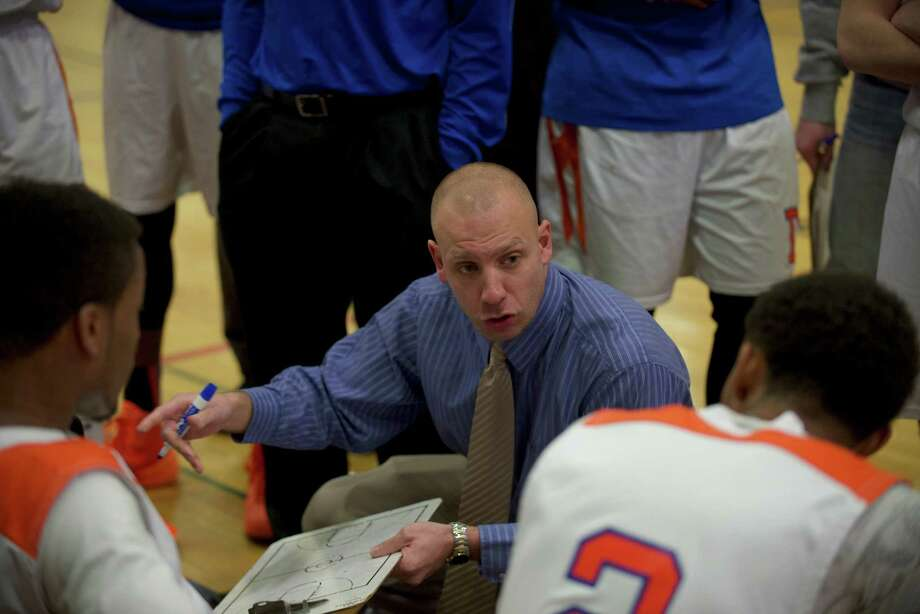 Danbury's head coach talks with his team during a boys FCIAC basketball game, St Josephs, of Trumbull, at Danbury High School, Danbury, Conn on Thursday, January 23, 2014. Photo: H John Voorhees III / The News-Times Freelance