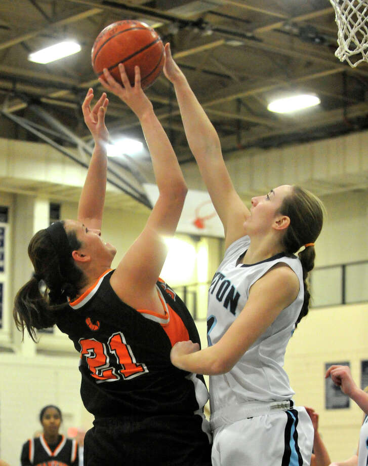 Wilton's Christina Holmgren blocks the shot of Stamford's Kelsey Santagata during their basketball game at Wilton High School in Wilton, Conn., on Monday, Jan. 27, 2014. Stamford won, 55-50. Photo: Jason Rearick / Stamford Advocate