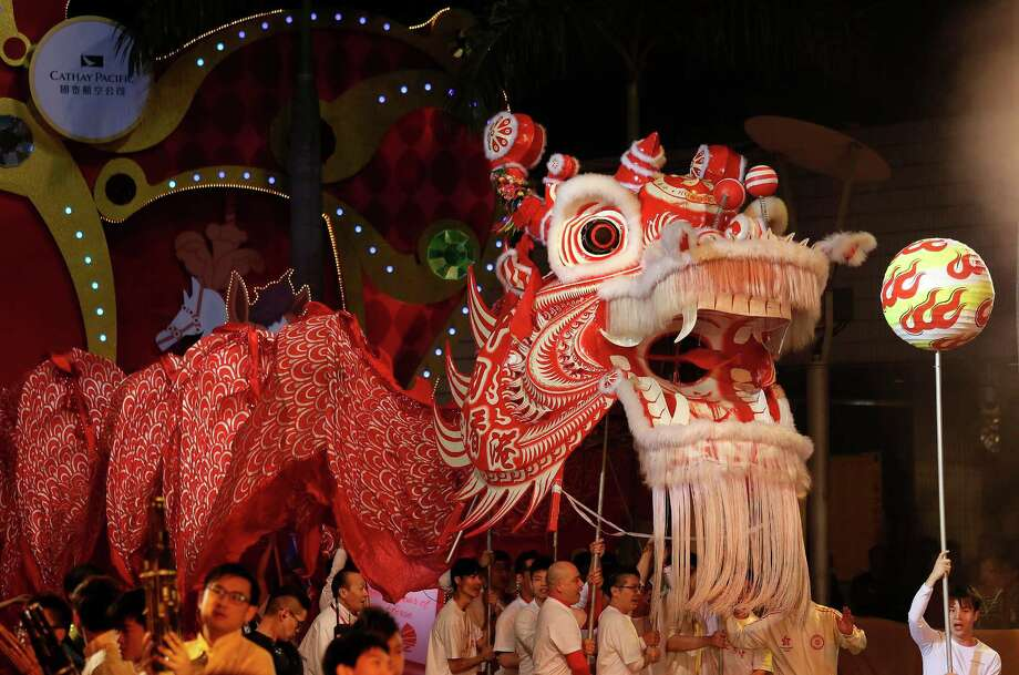 Performers take part in a night parade to celebrate Chinese New Year in Hong Kong, Friday, Jan. 31, 2014. The Lunar New Year this year marks the Year of the Horse in the Chinese calendar. (AP Photo/Vincent Yu) Photo: Vincent Yu, Associated Press / AP