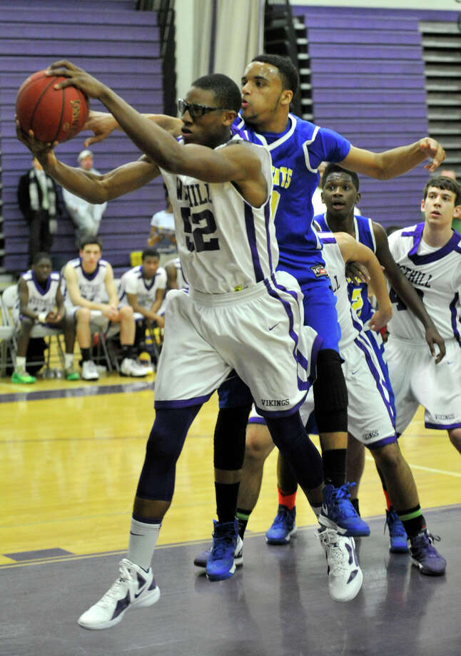 Westhill's Chianta' Holtzclaw snares the rebound away from Harding's Kanard Codrington during their basketball game at Westhill High School in Stamford, Conn., on Tuesday, Jan. 14, 2014. Westhill won, 67-50. Photo: Jason Rearick / Stamford Advocate