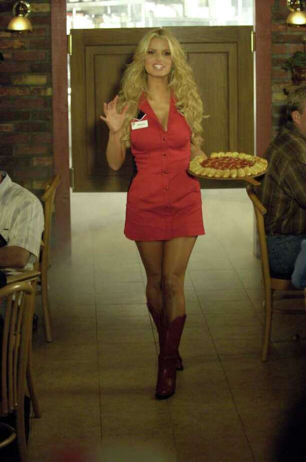 """Jessica Simpson:Remember Simpson singing """"These Bites are Made for Poppin'?"""" The Pizza Hut spokesgirl is actually -- gasp! -- allergic to pizza. Watch the ad here. Photo: PRASHANT GUPTA, ASSOCIATED PRESS / AP2006"""