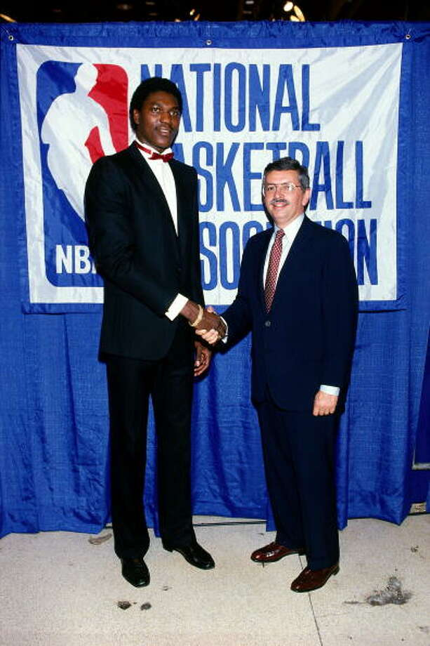 David Stern introduced Akeem Olajuwon as the No. 1 selection in the 1984 NBA Draft. This was Stern's first draft as the NBA's Commissioner and was also the final draft without a lottery to decide the top picks. Photo: Noren Trotman, NBAE/Getty Images / 2002 NBAE