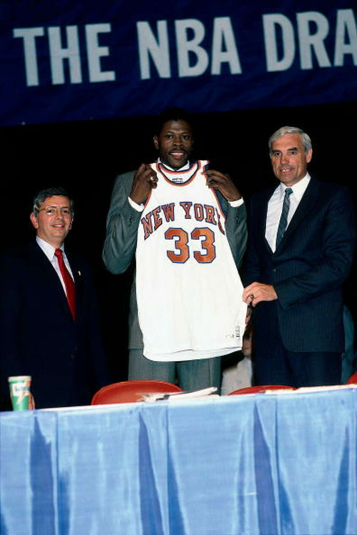 """1985 draft lottery This was the first lottery - thanks in large part to the Rockets' bad job of tanking the year before to get Hakeem Olajuwon - and the prize was Patrick Ewing. The Georgetown center was a household name after one national title and three trips to the NCAA championship game and the franchise that got him would be instantly better. The Knicks, playing in the league's biggest market, were terrible and desperately needed a franchise player. Naturally, they won the lottery, and conspiracy theories about a frozen or bent envelope with New York's logo inside it have raged on ever since. This is such a famous conspiracy theory that this picture of Ewing, NBA commissioner David Stern and then-Knicks general manager Dave DeBusschere is on the cover of the book """"The 30 Greatest Sports Conspiracy Theories of All Time."""""""