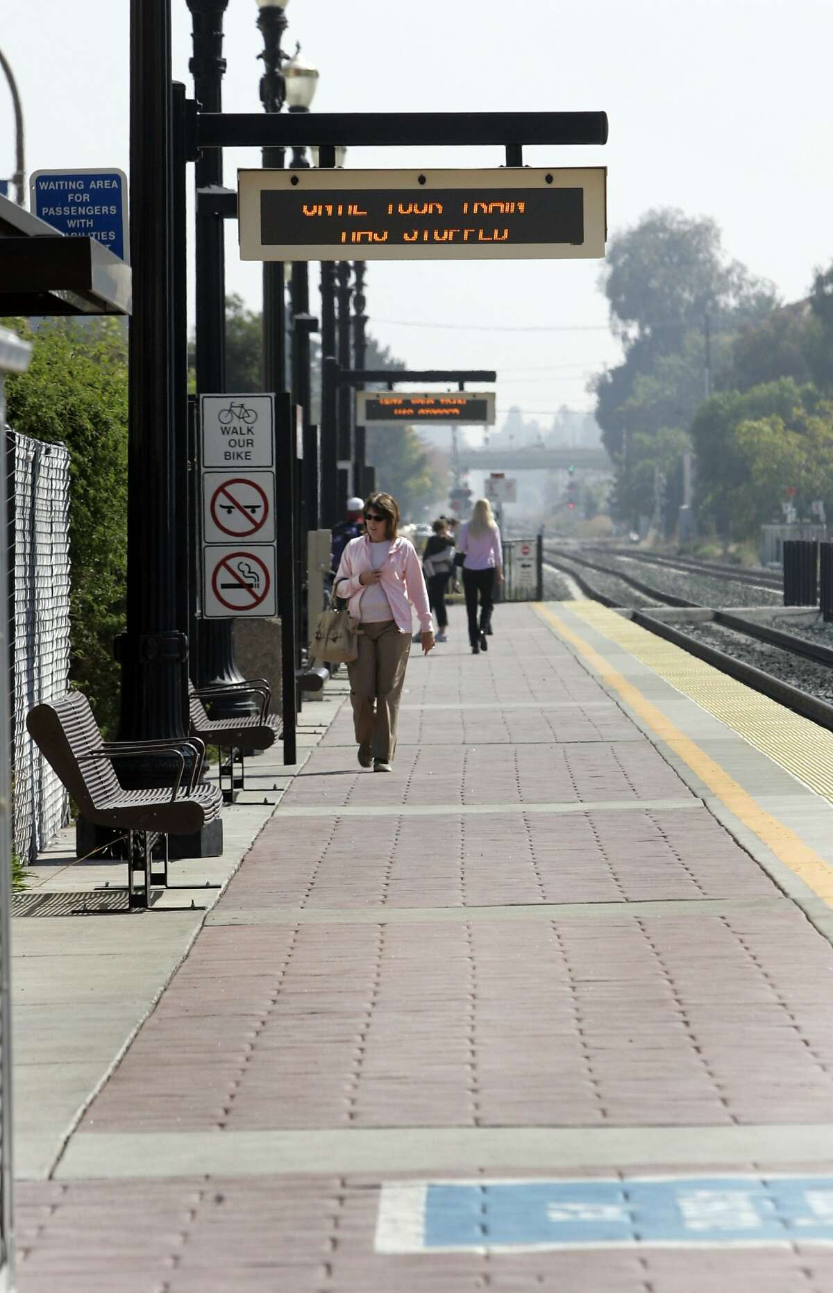 In this file photo, people walking about at the Caltrain station in Redwood City.