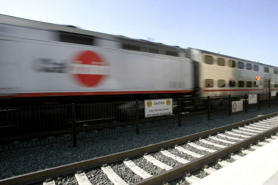 A file photo of a Caltrain in Redwood City. Caltrain was experiencing systemwide delays Wednesday morning, possibly the result of a power outage in San Jose, Photo: Penni Gladstone, SFC