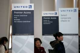 SAN FRANCISCO, CA - JANUARY 23:  People line up to check in for a United Airlines flight at San Francisco International Airport on January 23, 2014 in San Francisco, California. United Airlines parent company United Continental Holdings reported a surge in fourth quarter profits with earnings of $140 million compared to a loss of $620 million one year ago.  (Photo by Justin Sullivan/Getty Images)