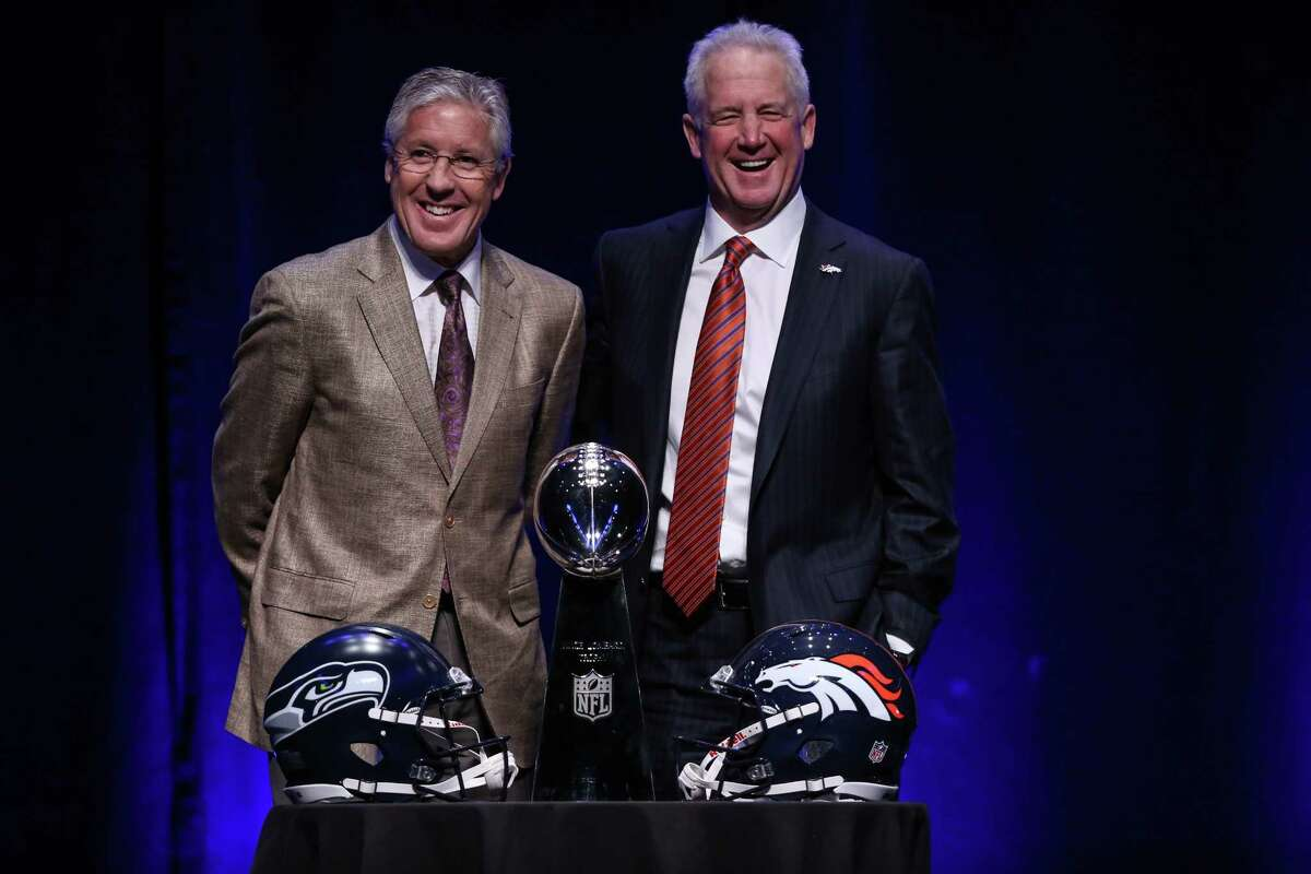 Seattle Seahawks coach Pete Carroll and Denver Broncos coach John Fox meet in front of the Vince Lombardi Trophy at the Rose Theater on Friday, January, 31, 2014 in New York City. The coaches spoke with the media in advance of Sunday's Super Bowl.
