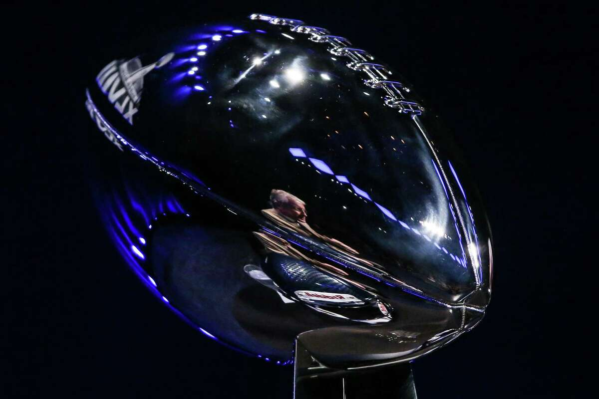 Seattle Seahawks coach Pete Carroll is reflected in the Vince Lombardi Trophy at the Rose Theater on Friday, January, 31, 2014 in New York City. The coaches spoke with the media in advance of Sunday's Super Bowl.
