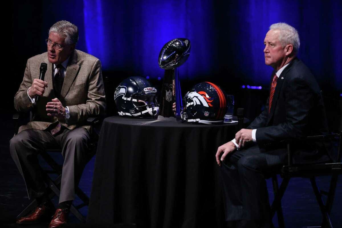 Seattle Seahawks coach Pete Carroll and Denver Broncos coach John Fox meet alongside the Vince Lombardi Trophy at the Rose Theater on Friday, January, 31, 2014 in New York City. The coaches spoke with the media in advance of Sunday's Super Bowl.