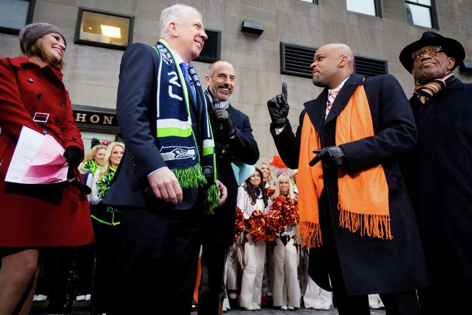 Seattle Mayor Ed Murray, center left, squares off with Denver Mayor Michael Hancock, center right, over Super Bowl XLVIII predictions on set of The Today Show during a Seahawks versus Broncos rally Friday, Jan. 31, 2014, at Rockefeller Center in New York City. Photo: JORDAN STEAD, SEATTLEPI.COM / SEATTLEPI.COM