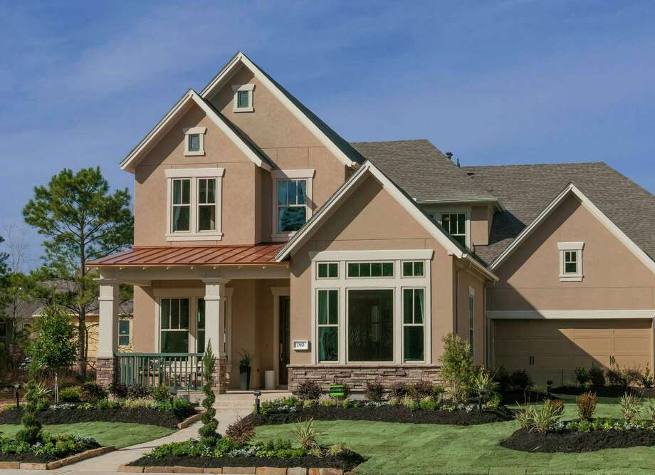 The Chiswell by David Weekley Homes is one of nine homes open for touring during the grand opening of Liberty Branch in The Woodlands' Village of Creekside Park. / Ted Washington