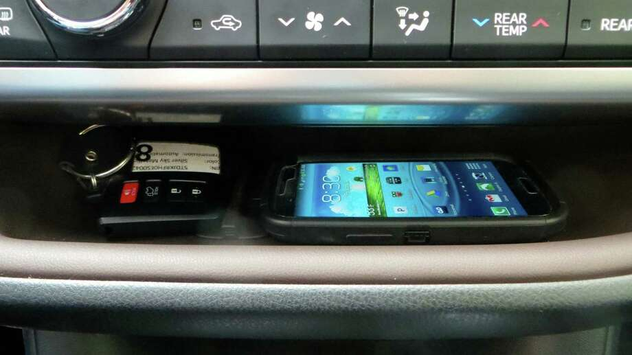 The family-friendly features new or improved for 2014 are many. Starting at the dash, there's a nifty storage shelf that's integrated along most of the dash.