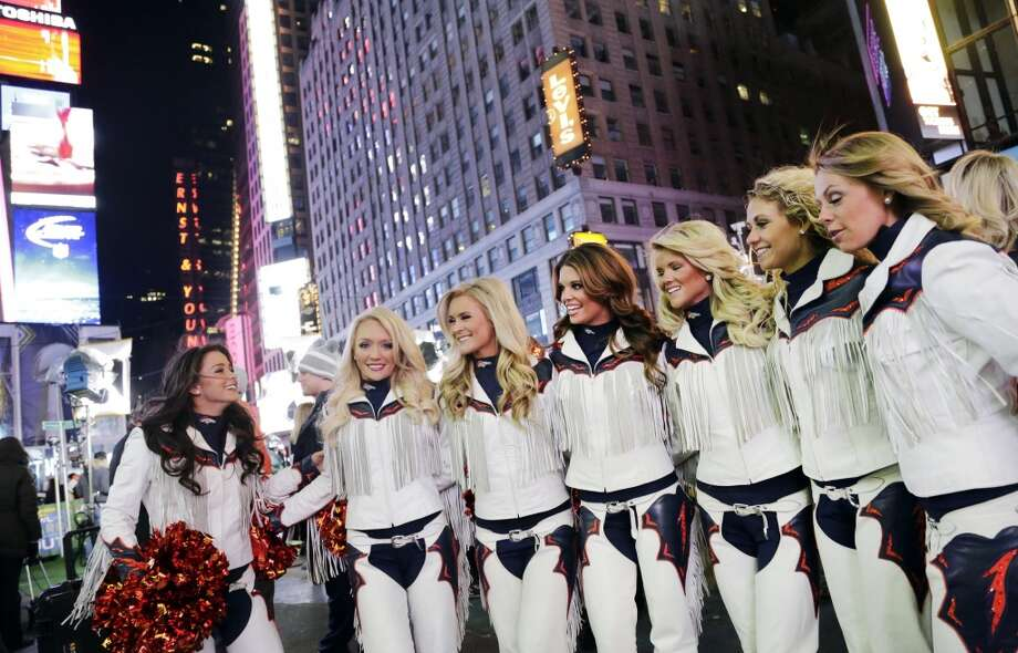 Members of the Denver Broncos cheerleading squad pose for photos following a promotional appearance on Super Bowl Boulevard, Friday, Jan. 31, 2014, in New York's Times Square. The Seattle Seahawks are scheduled to play the Broncos in the NFL Super Bowl XLVIII football game on Sunday, Feb. 2, at MetLife Stadium in East Rutherford, N.J. Photo: Mark Lennihan, Associated Press