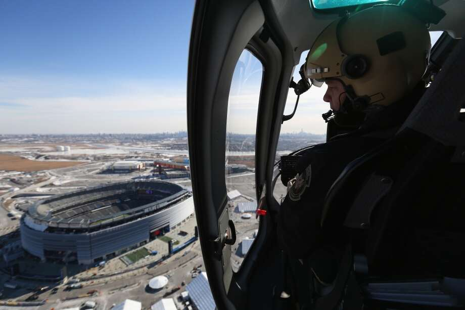 "A  Astar helicopter flown by U.S. Customs and Border Protection (CBP), flies past MetLife Stadium on January 28, 2014 in East Rutherford, New Jersey. The CBP aircraft flown by ""air interdiction agents"" from the U.S. Office of Air and Marine (OAM), are providing air support for Super Bowl XLVIII this Sunday. Photo: John Moore, Getty Images"