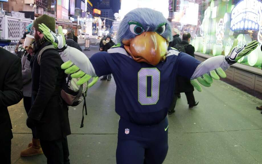 Blitz, the Seattle Seahawks mascot, walks through Times Square, Friday, Jan. 31, 2014 in New York. The Seattle Seahawks will play the Broncos Sunday in the NFL Super Bowl XLVIII football game in East Rutherford, N.J. Photo: Ted S. Warren, Associated Press