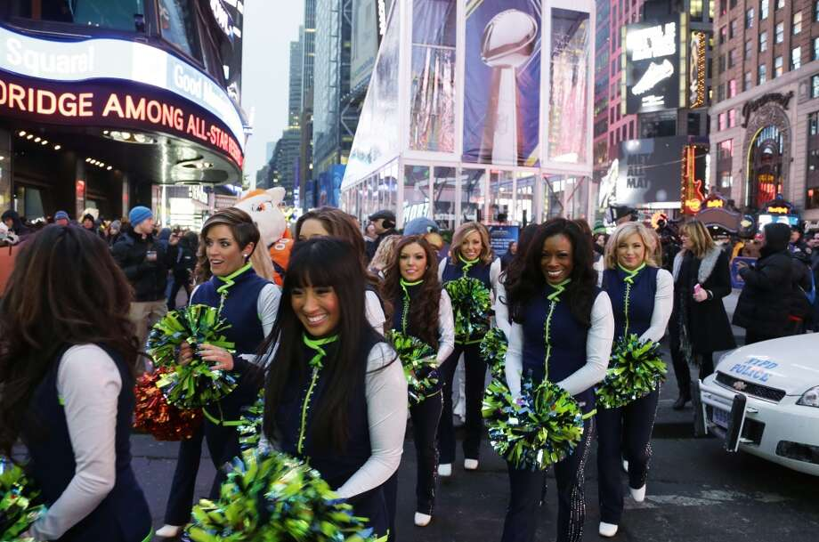 Seattle Seahawks Sea Gals cheerleaders cross the street Friday, Jan. 31, 2014 after appearing on a live broadcast of Good Morning America at Times Square in New York. The Seattle Seahawks will play the Denver Broncos Sunday in the NFL Super Bowl XLVIII football game in East Rutherford, N.J. Photo: Ted S. Warren, Associated Press