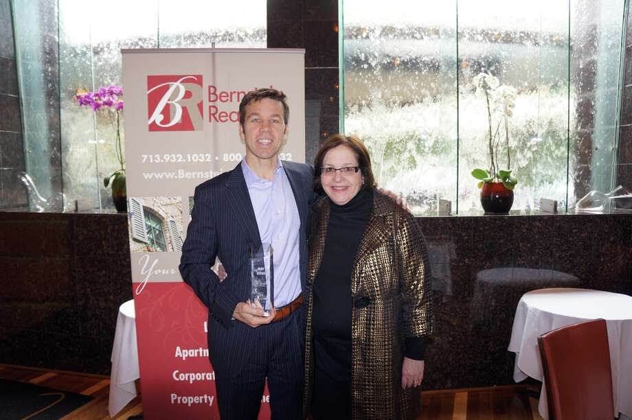 Bernstein Realty's 2013 Top Producer Rich Stone poses with Amy Bernstein.