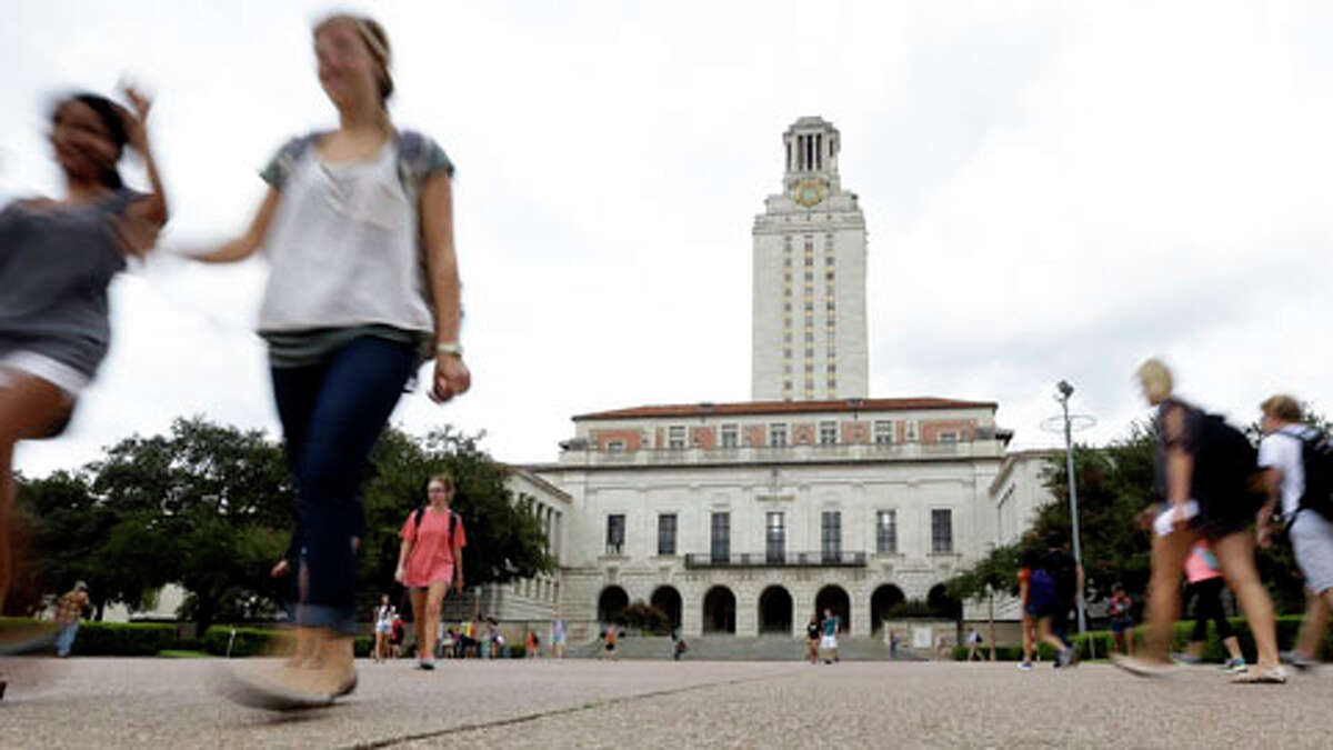In this Thursday, Sept. 27, 2012 photo, students walk through the University of Texas at Austin campus near the school's iconic tower in Austin, Texas.