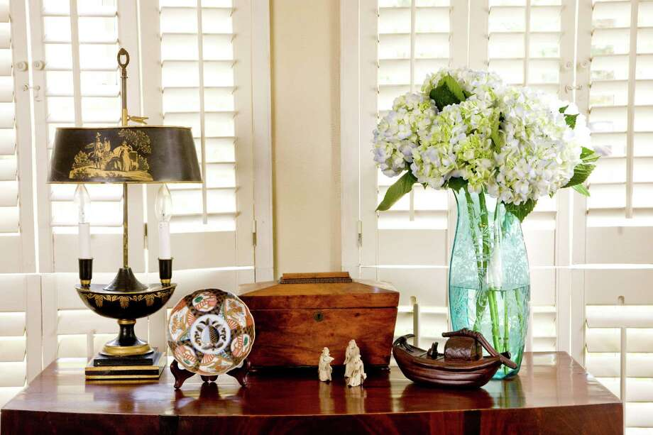 Hydrangea blossoms in a turqoise-blue vase bring early spring indoors. John Everett photo Photo: John Everett / John Everett