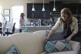 Julie Young of BY Design Home Staging preps for showings at a house by Monterey Homes in The Sanctuary in the Dominion.