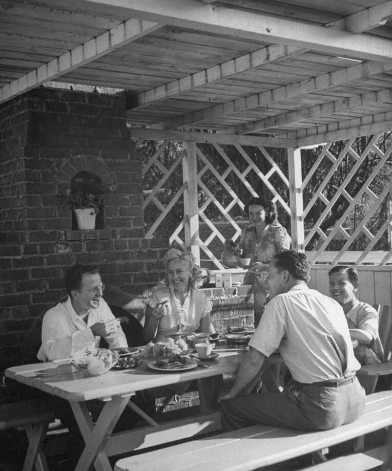 A family enjoying an outdoor barbecue in 1945. Photo: Nina Leen, Time & Life Pictures/Getty Image