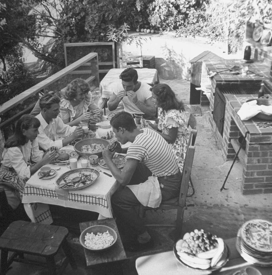 Young people enjoying an outdoor barbeque in California, 1945. Photo: Nina Leen, Time & Life Pictures/Getty Image