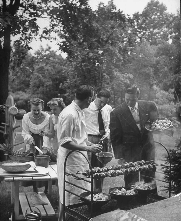 Socialites getting ready for a barbeque picnic, 1949. Photo: Nina Leen, Time & Life Pictures/Getty Image