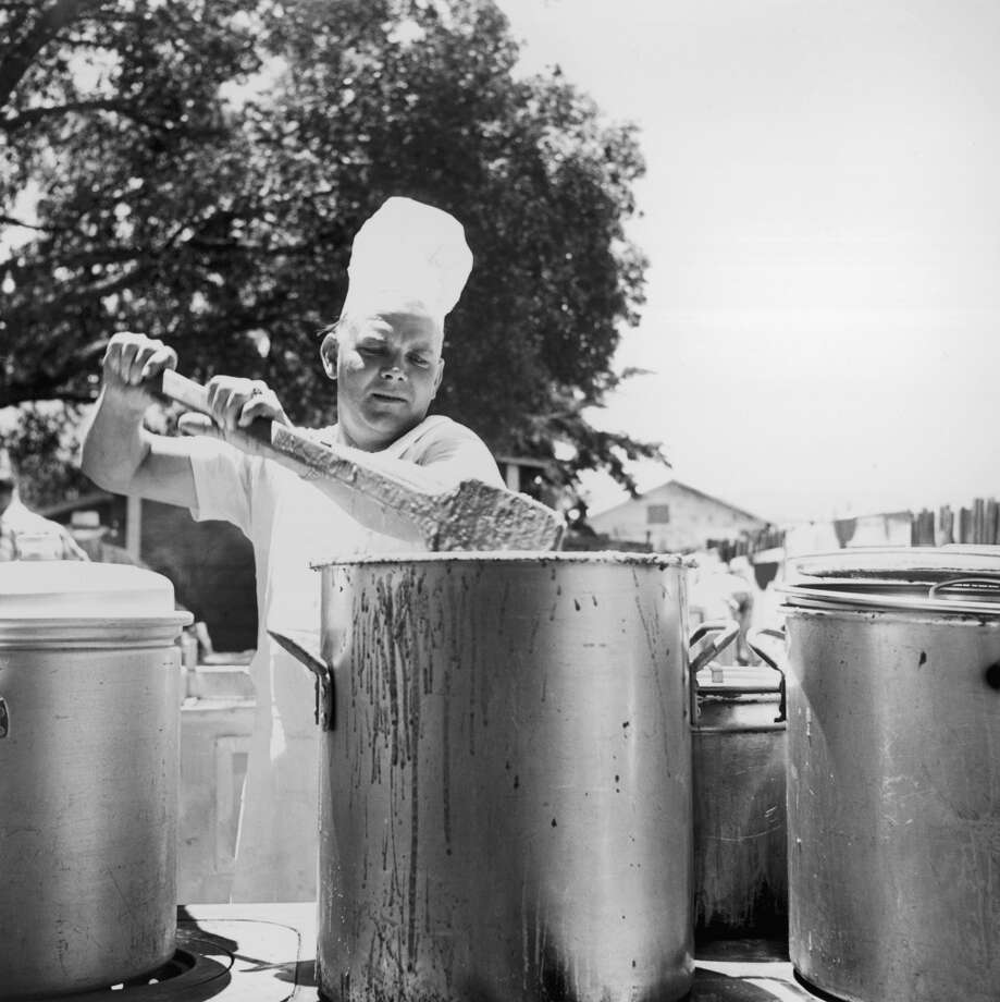 A California man stirs a pot of barbecue sauce in 1953. Photo: Hulton Archive, Getty Images