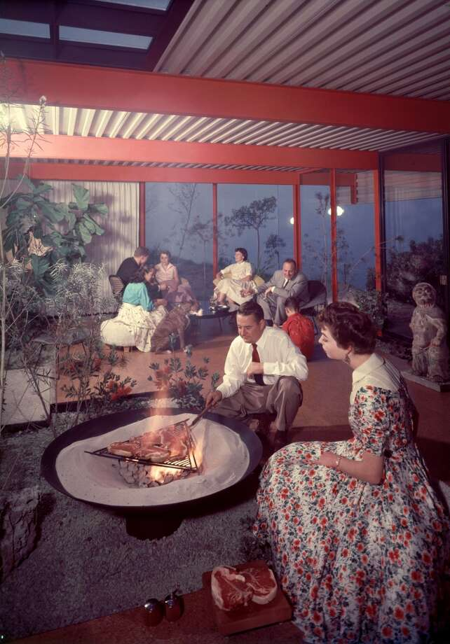 The outdoor grill moves indoors as architect Quincy Jones grills porterhouse steaks in the middle of his living room for dinner guests, San Pedro, California, 1955. Photo: Eliot Elisofon, Time Life Pictures/Getty Images
