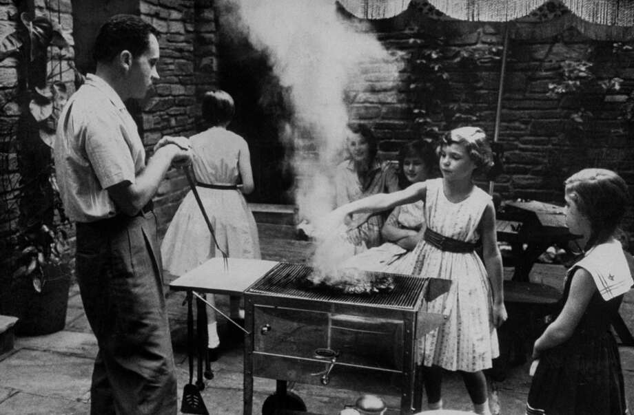 Vice President Richard Nixon and his family during an outdoor barbecue in 1958. Photo: Hank Walker, Time & Life Pictures/Getty Image