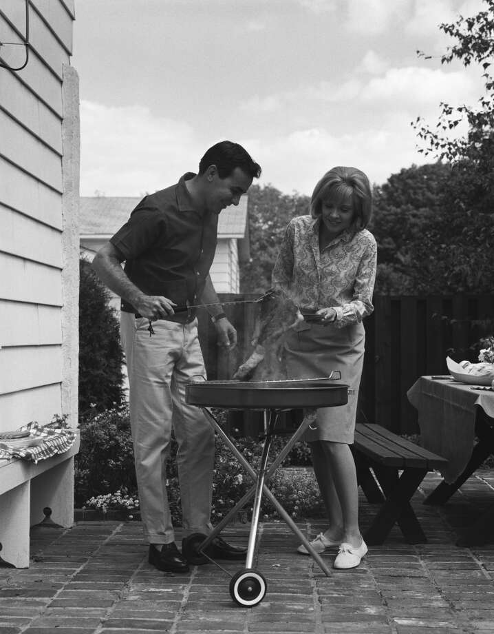 Taking steak off a grill in the 1960s. Photo: H. Armstrong Roberts, Retrofile/Getty Images