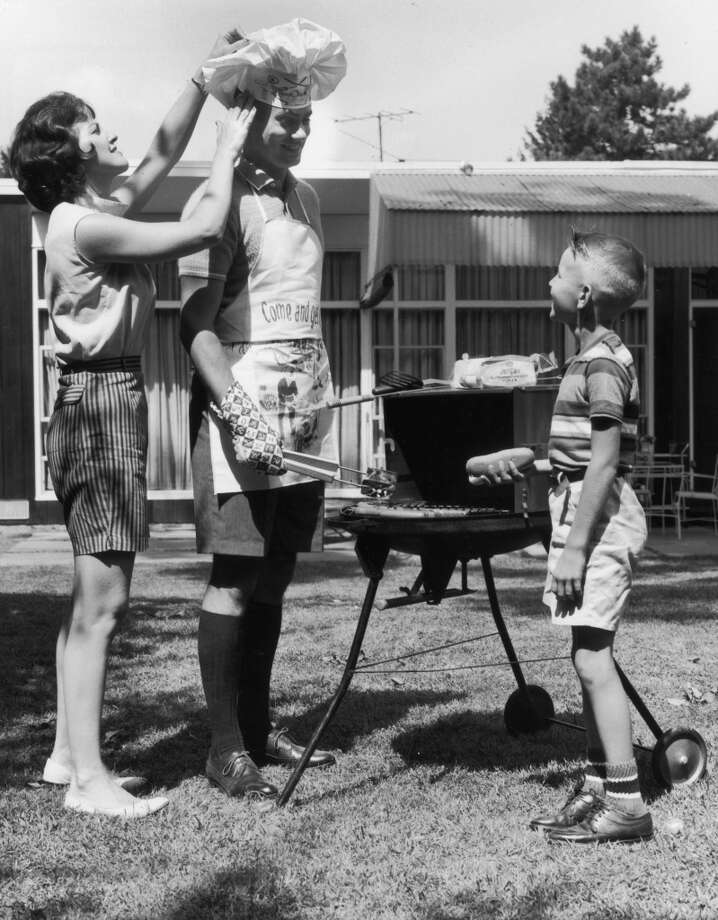 A family cooking out in 1961. Photo: Harold M. Lambert, Getty Images