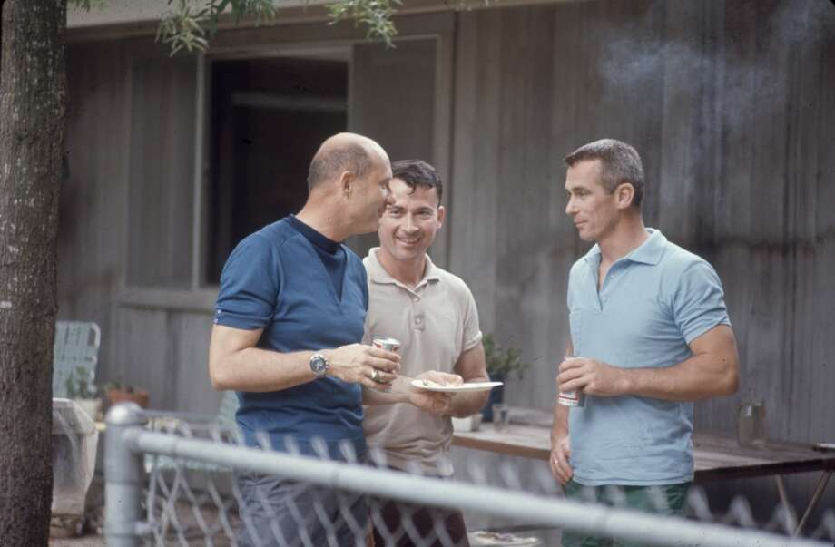 Apollo astronauts Eugene Cernan (in blue), Thomas Stafford (center, shirtless), and John Young (right) at a barbeque outside Young's Houston home in 1969. Photo: Ralph Morse, Time & Life Pictures/Getty Image