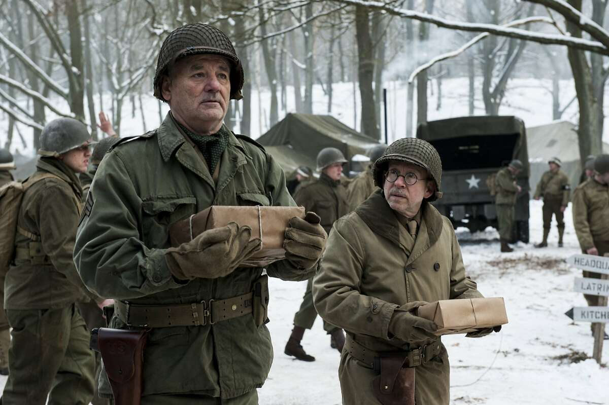 Patton's Camp - St Vith - Preston Savitz (BOB BALABAN, right) and Richard Campbell (BILL MURRAY) collect their care packages in Columbia Pictures' THE MONUMENTS MEN.