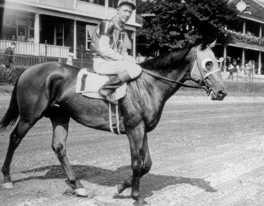 circa 1937:  American racehorse 'Seabiscuit' with one eyed jockey Johnny 'Red' Pollard. Photo: Keystone, Getty Images / Hulton Archive