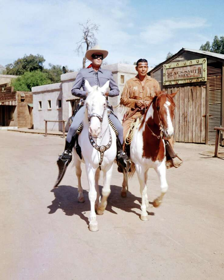 The Lone Ranger (Clayton Moore) rides Silver, and Tonto (Jay Silverheels) Scout.  Photo: Silver Screen Collection, Getty Images / Moviepix
