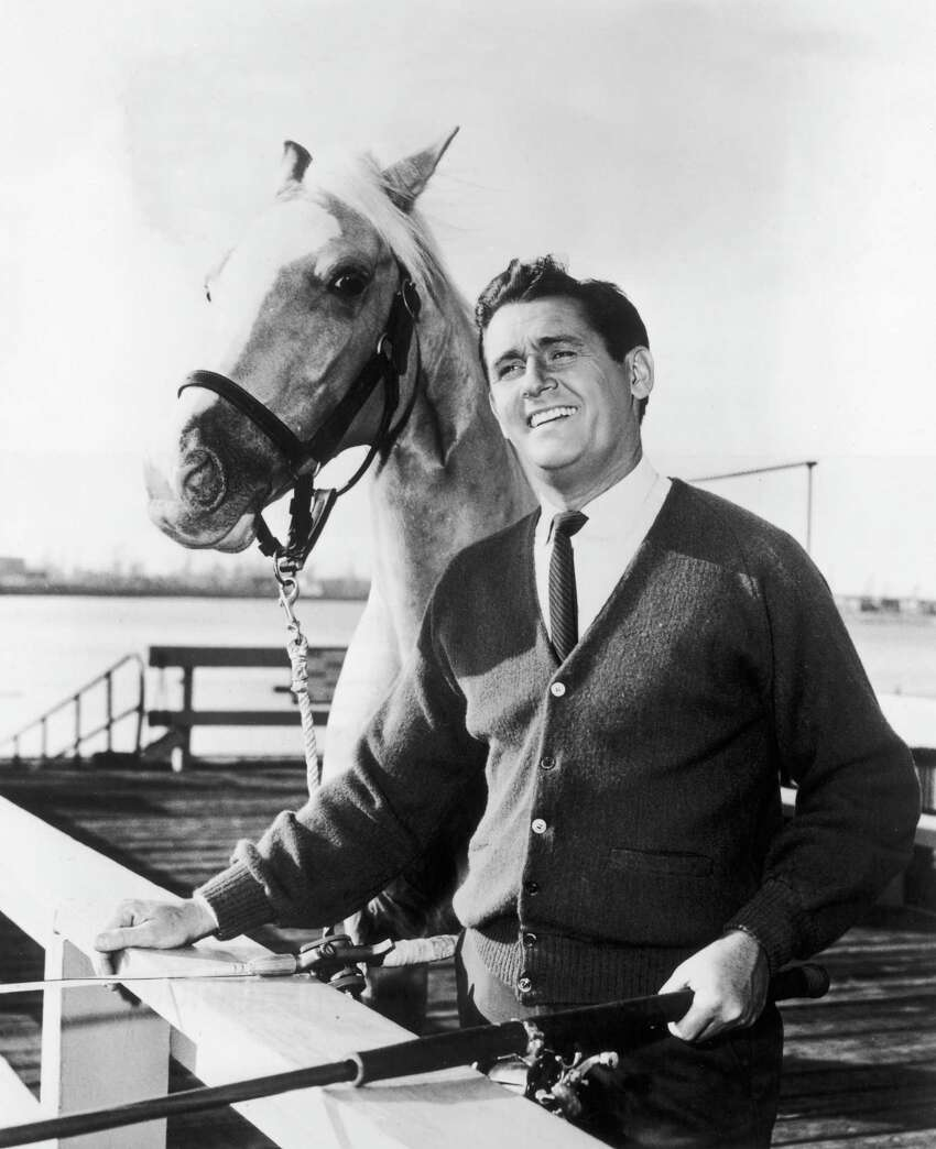 circa 1964: British-born actor Alan Young and Mr Ed, the talking horse, pose together in a promotional portrait for the television comedy series, 'Mr Ed'.