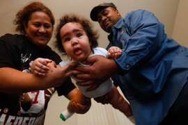 Pava Otuhiva, right, and Sosefina Tagalu, hold their son, Sammisano Otuhiva, five months, at their home in Daly City, Calif., on Thursday, Jan. 30, 2014. The younger Otuhiva was 16 lbs. 1.74 oz. at birth.
