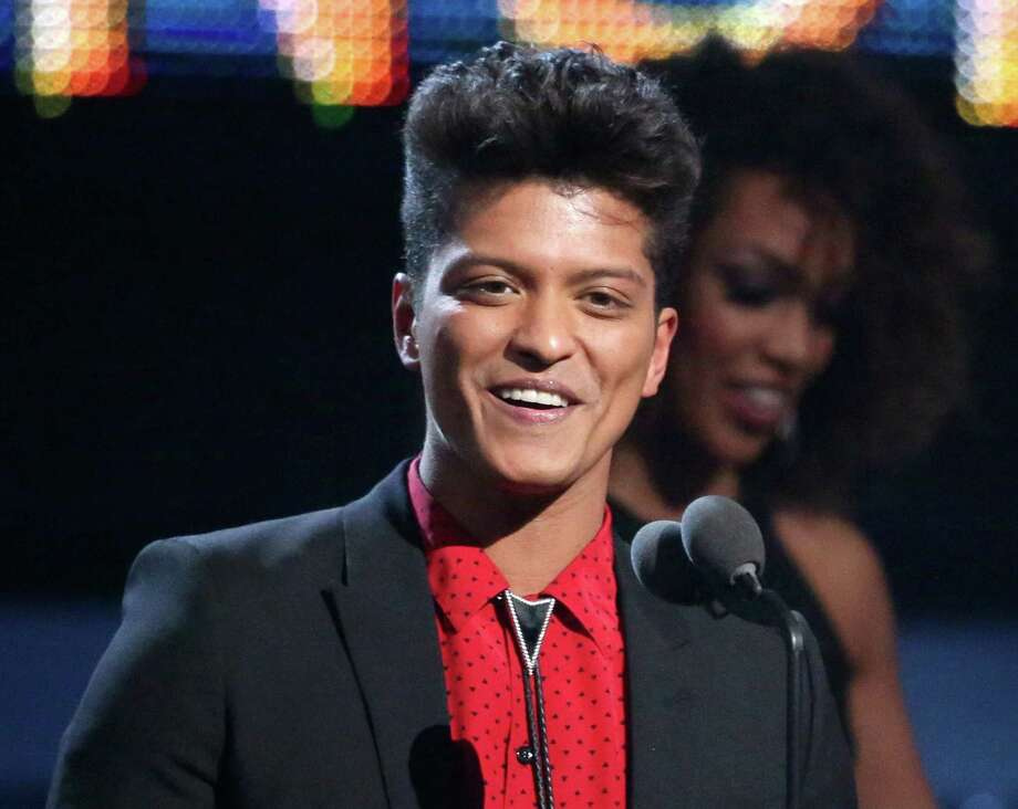 "FILE - This Jan. 26, 2014 file photo shows Bruno Mars accepting the award for best pop vocal album for ""Unorthodox Jukebox"" at the 56th annual Grammy Awards in Los Angeles. Mars will answer questions about his Super Bowl halftime performance at the Rose Theater in the Time Warner Center in New York City on Thursday. Renee Fleming, who will sing the national anthem, will give a press conference before Mars. (Photo by Matt Sayles/Invision/AP, File) ORG XMIT: NYET400 Photo: Matt Sayles / Invision"