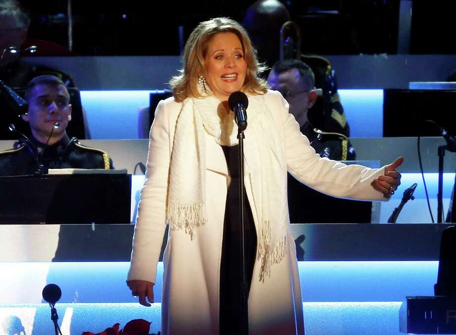 FILE - This Dec. 6, 2013 file photo shows Renee Fleming performing at the National Christmas Tree lighting ceremony across from the White House in Washington. Fleming, a four-time Grammy winner, will perform sing the national anthem before the Denver Broncos take on the Seattle Seahawks at MetLife Stadium in East Rutherford, N.J. on Feb 2. (AP Photo/Charles Dharapak, File) ORG XMIT: NYET105 Photo: Charles Dharapak / AP