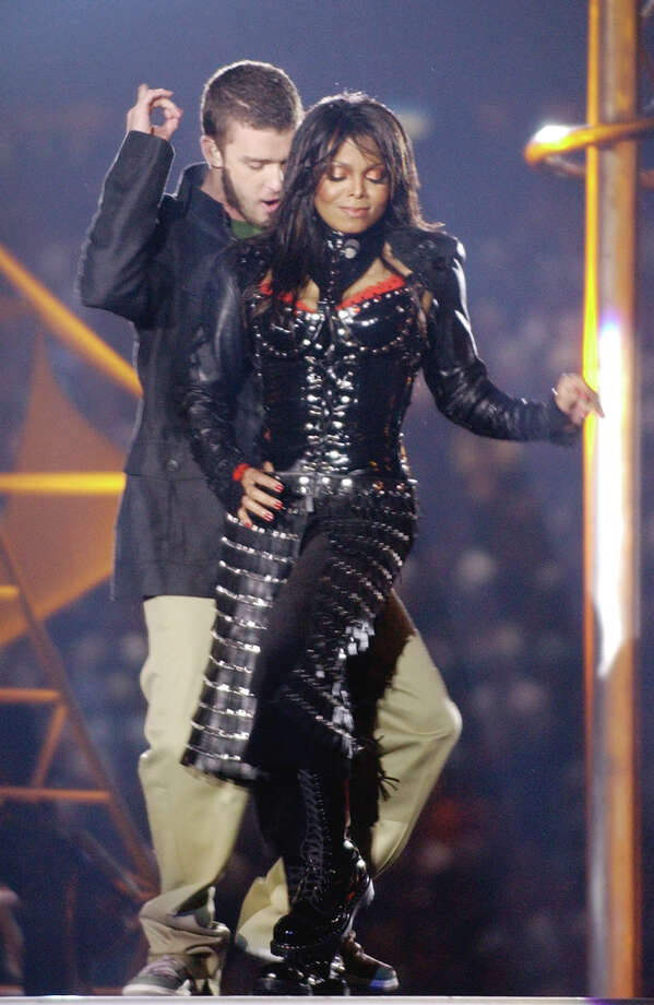Justin Timberlake and Janet Jackson perform during halftime of Super Bowl XXXVIII Sunday, Feb. 1, 2004, in Houston. The chief federal regulator of broadcasting was outraged by the Super Bowl halftime show and ordered an investigation after part of Jackson's costume was torn off, exposing her breast. (AP Photo/Elise Amendola) Photo: ELISE AMENDOLA / AP
