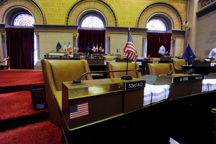 The nameplate of former New York Assemblyman Vito Lopez has been removed from his seat in the Assembly Chamber at the Capitol in Albany, N.Y., Monday, May 20, 2013. Now that Vito, the Democrat at the center of a sexual harassment scandal in the state Assembly, has resigned, the Democratic majority is planning reforms. (AP Photo/Tim Roske) Photo: Tim Roske / FR61503 AP