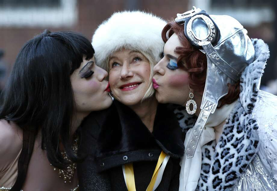 Pudding op: Actress Helen Mirren is kissed by actors Tony Oblen (left) and Ethan Hardy as she is honored as Woman of the Year by Harvard University's Hasty Pudding Theatricals in Cambridge, Mass. Photo: Associated Press