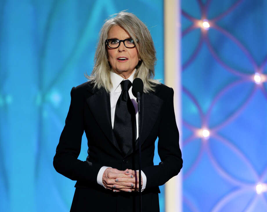 This image released by NBC shows Diane Keaton accepting the Cecil B. DeMille award on behalf of Woody Allen during the 71st annual Golden Globe Awards at the Beverly Hilton Hotel on Sunday, Jan. 12, 2014, in Beverly Hills, Calif. (AP Photo/NBC, Paul Drinkwater) Photo: Paul Drinkwater, HOEP / NBC