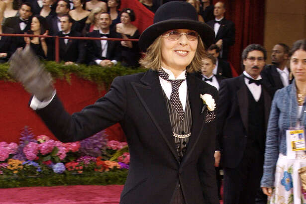 """Diane Keaton arrives for the 76th annual Academy Awards Sunday, Feb. 29, 2004, in Los Angeles. Keaton is nominated for best actress in a leading role for her work in """"Somethings Gotta Give."""" (AP Photo/Reed Saxon).  HOUCHRON CAPTION (03/01/2004):  Diane Keaton tops her Ralph Lauren black slacks and men's jacket with a quirky bowler hat."""