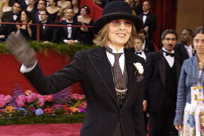 "Diane Keaton arrives for the 76th annual Academy Awards Sunday, Feb. 29, 2004, in Los Angeles. Keaton is nominated for best actress in a leading role for her work in ""Somethings Gotta Give."" (AP Photo/Reed Saxon).  HOUCHRON CAPTION (03/01/2004):  Diane Keaton tops her Ralph Lauren black slacks and men's jacket with a quirky bowler hat."