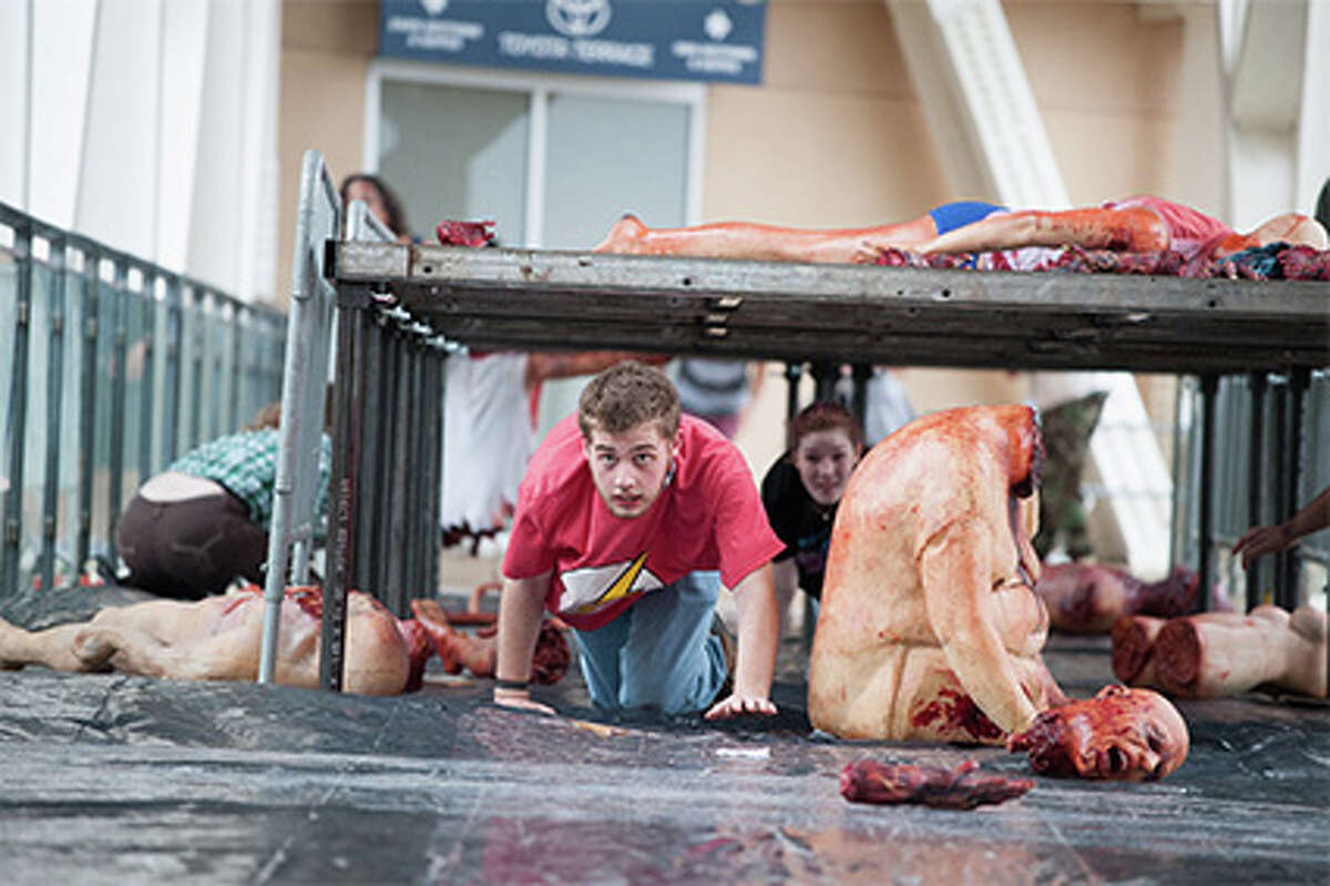 """""""The Walking Dead Escape"""" is the official obstacle course of the comic-turned-TV hit """"The Walking Dead."""" In Escape, entrants attempt to navigate a post-apocalyptic world overrun by zombies. The event comes to Houston's Reliant Park on Saturday, April 26. Prior events, like the one pictured here, have taken place at San Diego's Comic-Con, New York City and Philadelphia."""